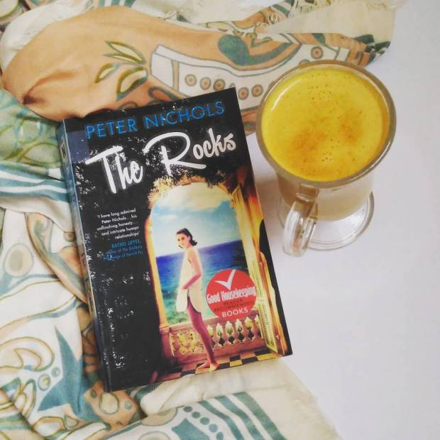Glass of golden milk and a book